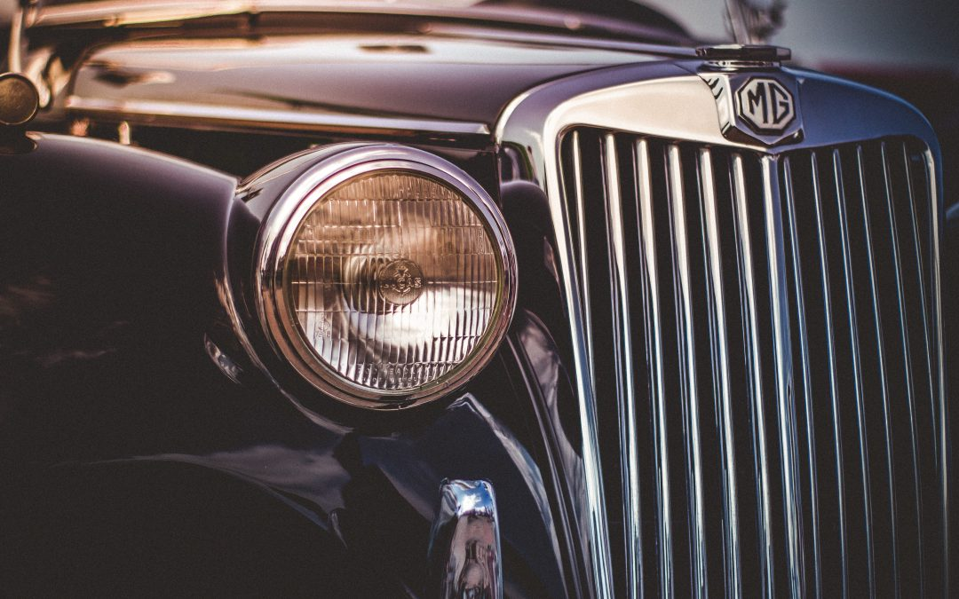 Image of the front of a vintage MG car.