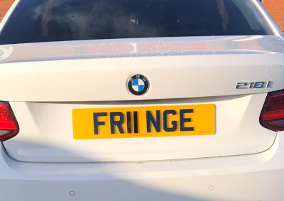 Image of a rear UK private 4D number plate on a white BMW vehicle.