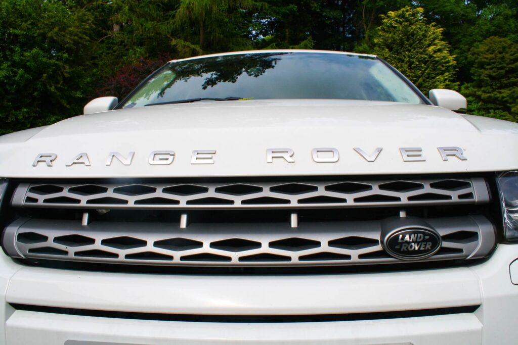 Common Car Radiator Issues: Image of the radiator grille on a white Range Rover.
