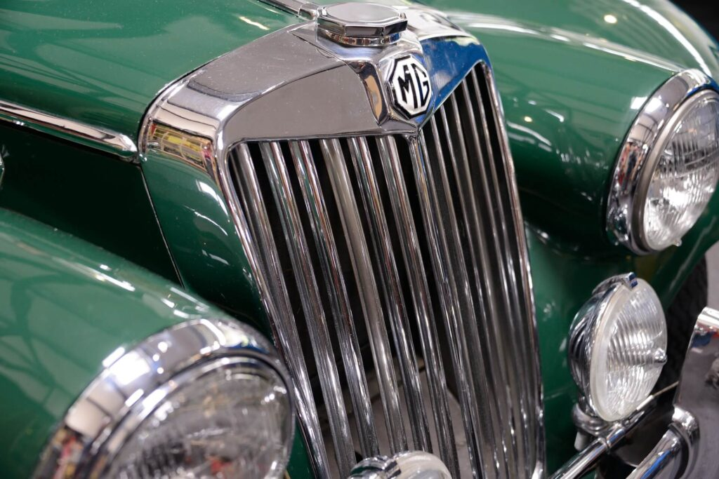 Common Car Radiator Issues: Image of the radiator grille on a green MG car.